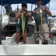 Couple holding two Dorado on the back of the El Pargo II